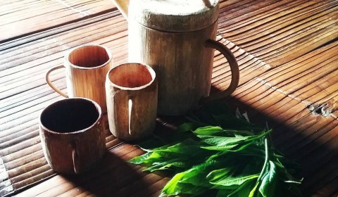 Drink tea with bamboo cup ....